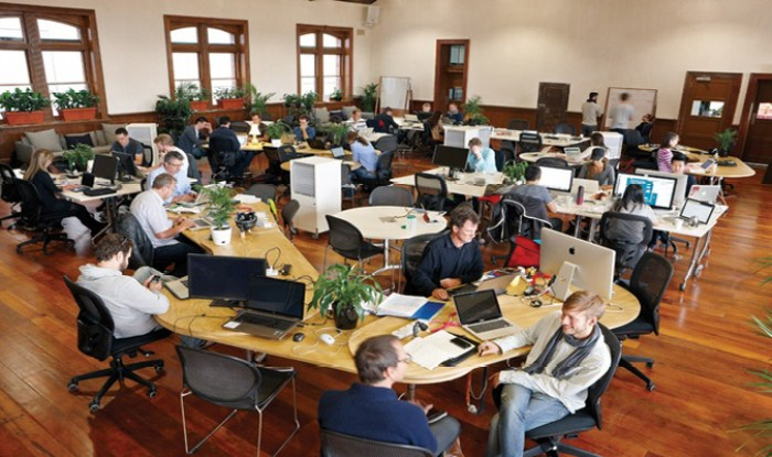 Open office with several people sitting at the desks