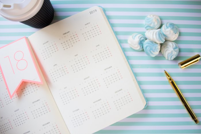 Open 2019 calendar with a coffee cup and pen also on the table