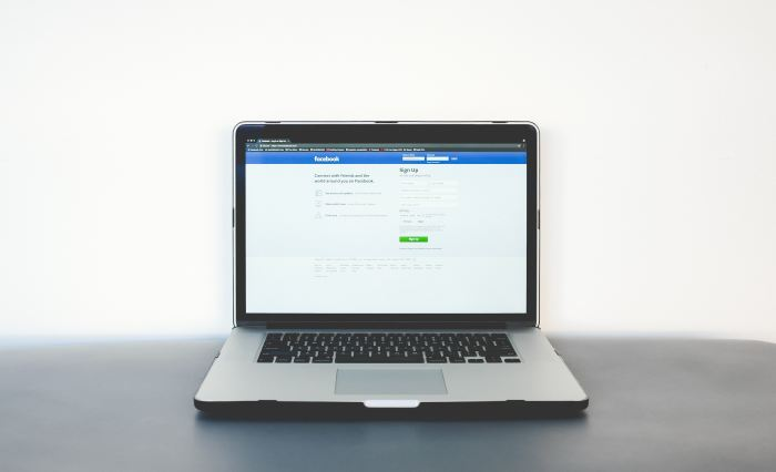An open laptop with Facebook login page on the screen