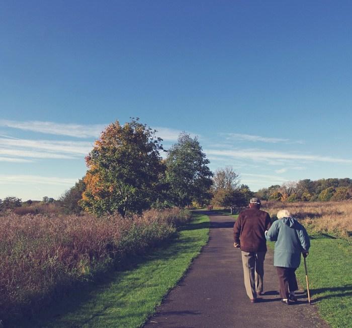couple walking along a path - retirement