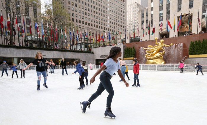 People ice skating at the Rink at Rockefeller Center
