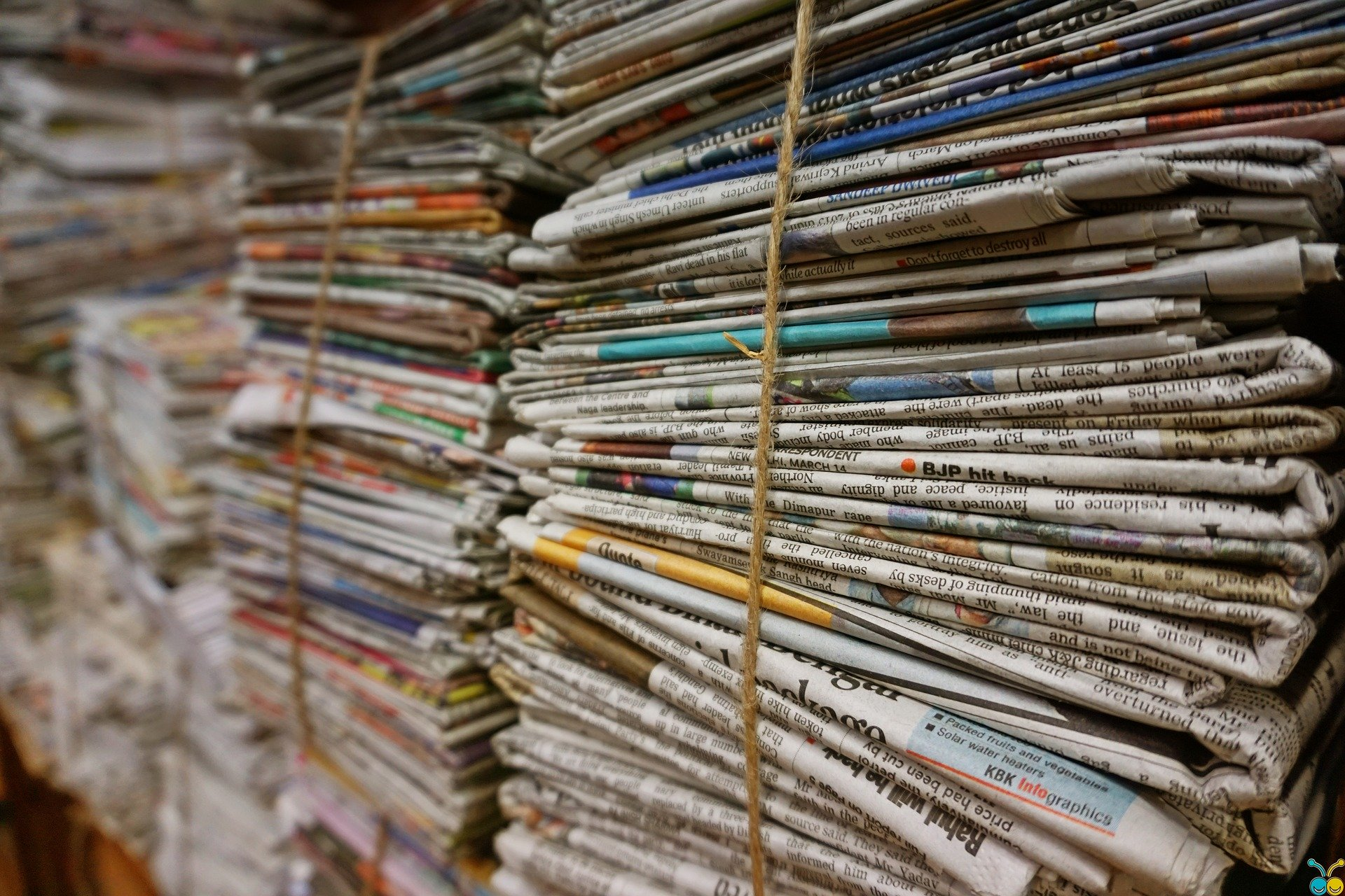 Stacks of newspapers tied together with rope