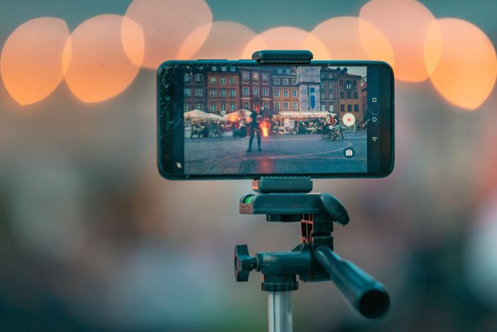 Smartphone on a tripod recording a performance