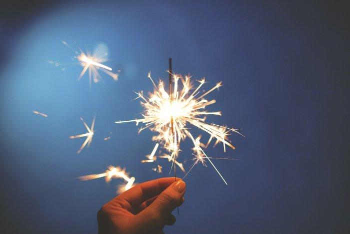 Media Insider Jan 3 2020 - Hand holding a sparkler firework