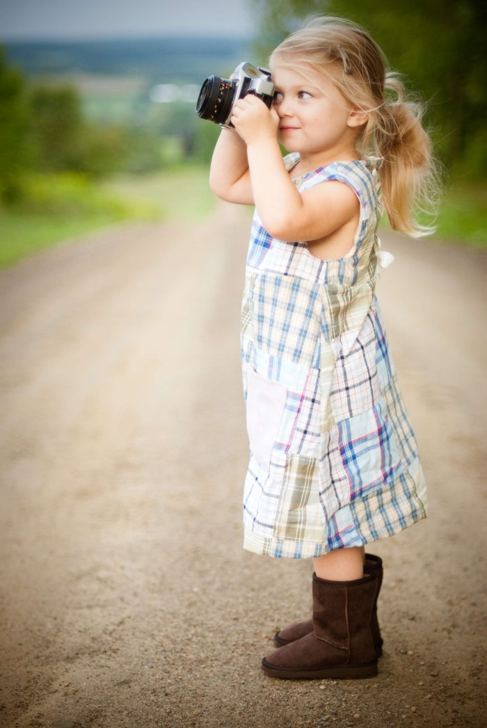 Couples Photography Tips - young girl holding a camera