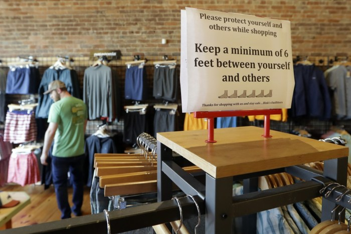 Social distancing sign in a retail store