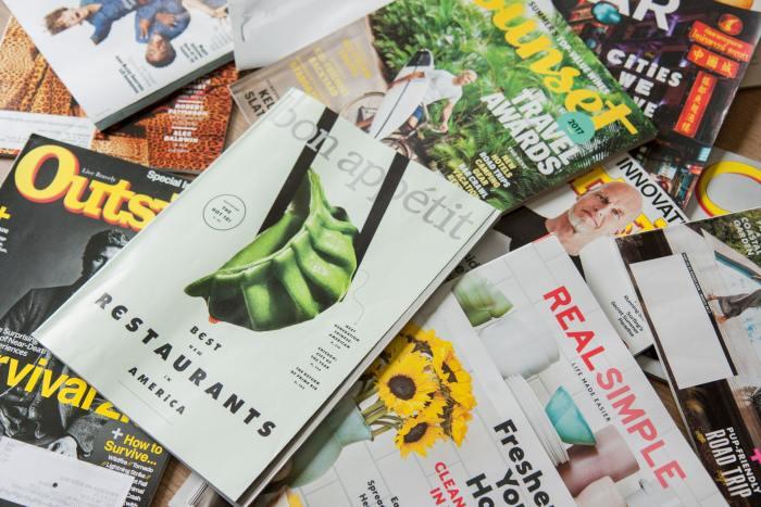 magazines strewn across a desk