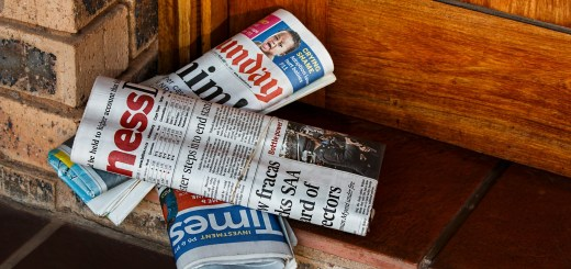 Image of several newspapers on a doorstep