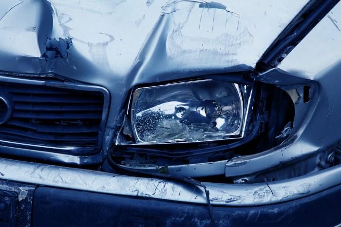 closeup photo of a broken car headlight