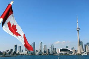 Canadian flag in front of the Toronto skyline