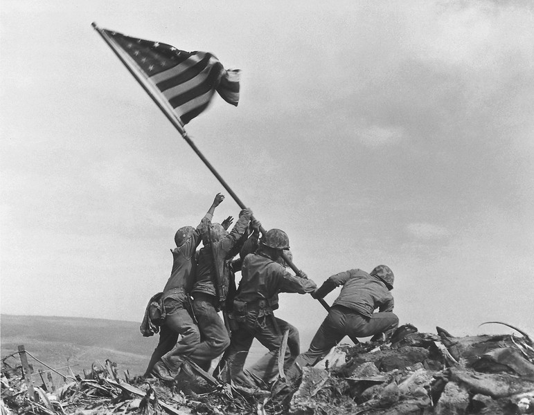 Description of  Feb. 23, 1945: U.S. Marines of the 28th Regiment, 5th Division, raise the American flag atop Mt. Suribachi, Iwo Jima. Strategically located only 660 miles from Tokyo, the Pacific island became the site of one of the bloodiest, most famous battles of World War II against Japan. (AP Photo/Joe Rosenthal)