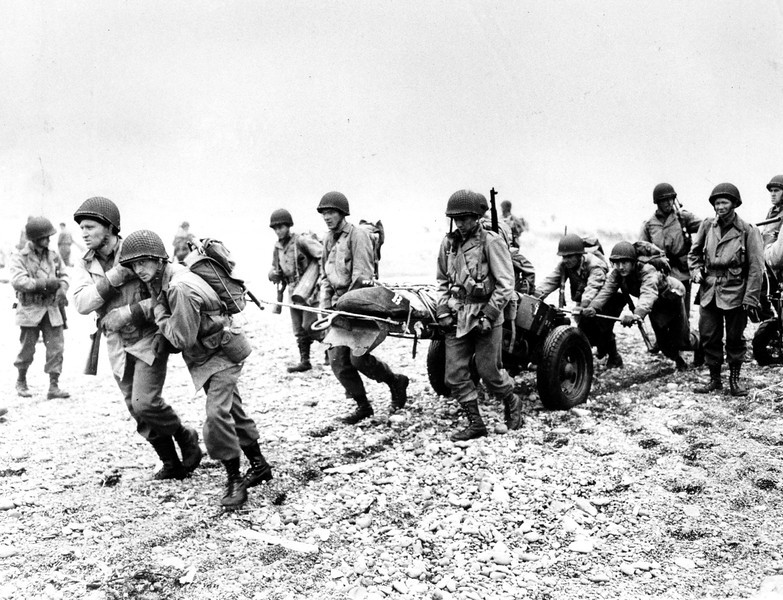 Description of  June 23, 1943: U.S. Army reinforcements land on a beach in Attu, Alaska on during World War II. U.S. troops invaded Attu on May 11 to expel the Japanese from the Aleutians. (AP Photo)