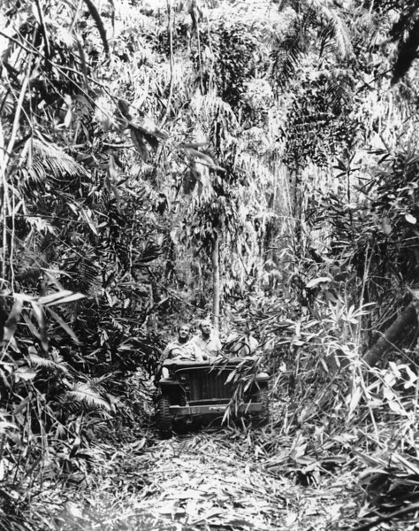 Description of  February 2, 1943: An American jeep proceeds along a trail through the jungle on Guadalcanal, Solomon Islands during World War II. (AP Photo)