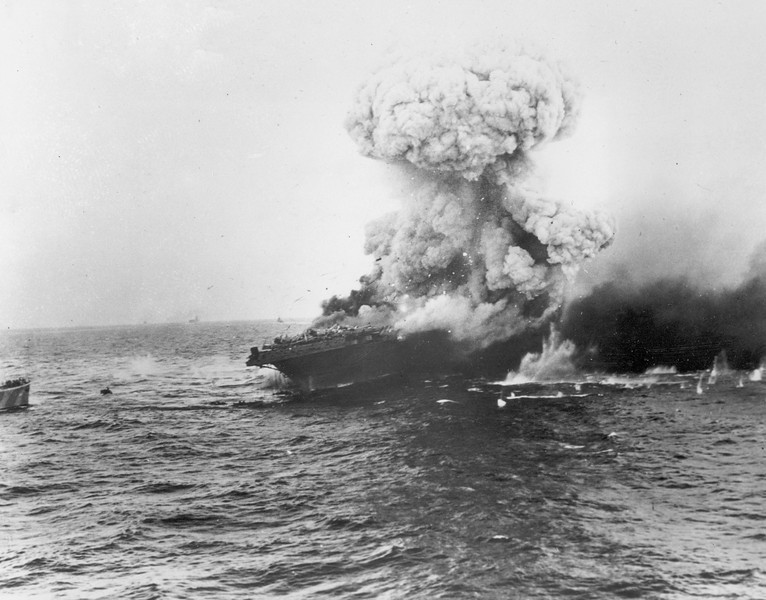 Description of  June 1942: The USS Lexington, U.S. Navy aircraft carrier, explodes after being bombed by Japanese planes in the Battle of the Coral Sea in the South Pacific during World War II. (AP Photo)