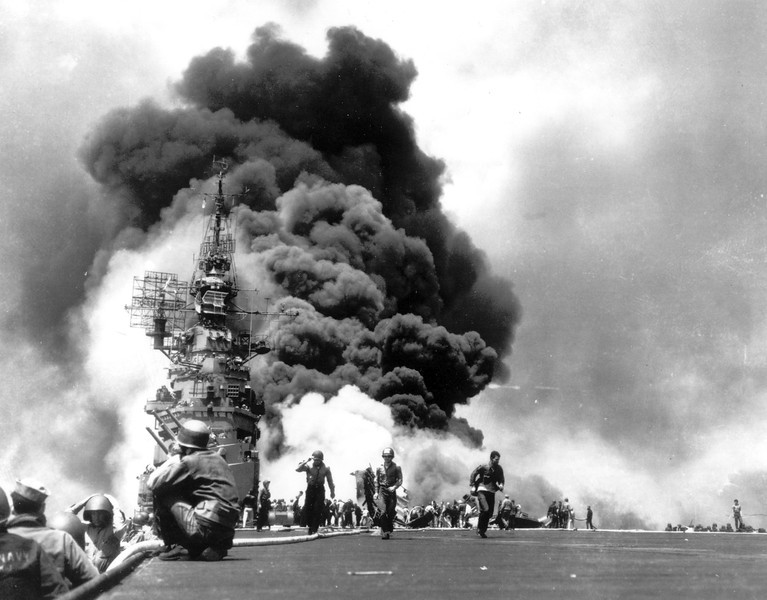 Description of  May 11, 1945: While supporting the Okinawa invasion, the USS Bunker Hill is hit and severely damaged by two Japanese Kamikaze planes off the coast of Kyushu, Japan. The ship suffered 372 dead and 264 injured. (AP Photo)