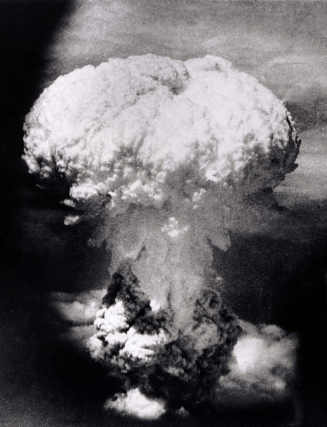 Description of  Aug. 9, 1945: A massive column of billowing smoke, thousands of feet high, mushrooms over the city of Nagasaki, Japan, after an atomic bomb was dropped by the United States. A B-29 plane delivered the blast killing approximately 70,000 people, with thousands dying later of radiation effects. The attack came three days after the U.S. dropped the world's first atomic bomb on the Japanese city of Hiroshima. The attacks brought about Japan's unconditional surrender. (AP Photo/U.S.Signal Corps)