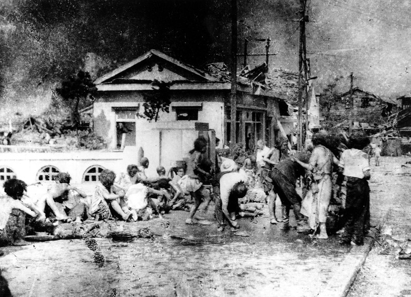 "Description of  Aug. 6, 1945: Japanese victims wait to receive first aid in the southern part of Hiroshima, Japan, a few hours after the U.S. atomic bomb exploded in the heart of the city. The explosion of the first A-bomb, known as ""Little Boy,"" instantly killed 66,000 people and injured another 69,000 people. (AP Photo)"