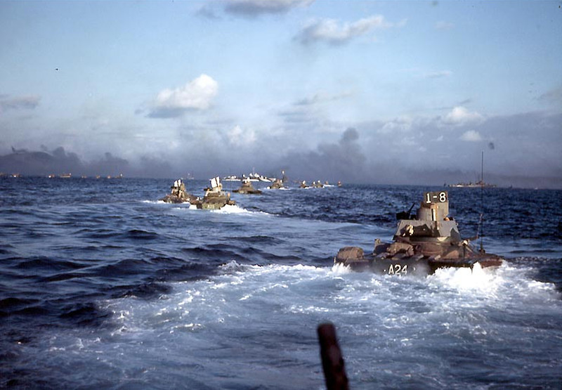 Description of  February 1945: Amphibious tractors underway of the coast of Iwo Jima. (US Navy photo)