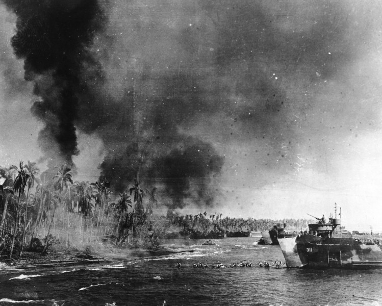 Description of  October 20, 1944: U.S. troops head toward the beaches of Leyte island during the amphibious assault to reconquest the Philippines. (AP Photo)