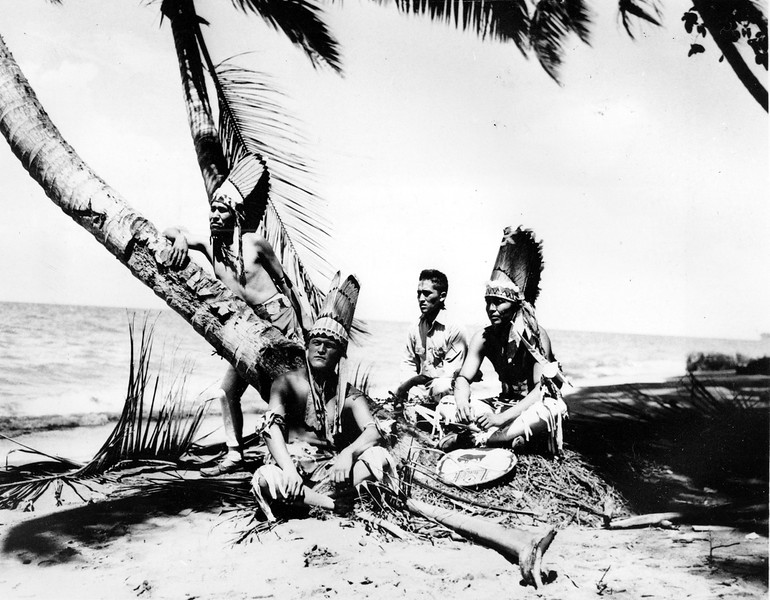 Description of  Dec. 1943: American Navajo Indians from Southwest United States, members of the 158th U.S. Infantry, are seen on a beach in the Solomon Islands. They are in their traditional dress for a tribal ceremony at Christmastime. From left to right are, Pfc. Dale Winney, Gallup, N.M; Pvt. Perry Toney, Holbrook, Ariz.; Pfc. Joe Gishi, Holbrook; and Pfc. Joe Taraha, Gallup. (AP Photo/U.S. Army Signal Corps)