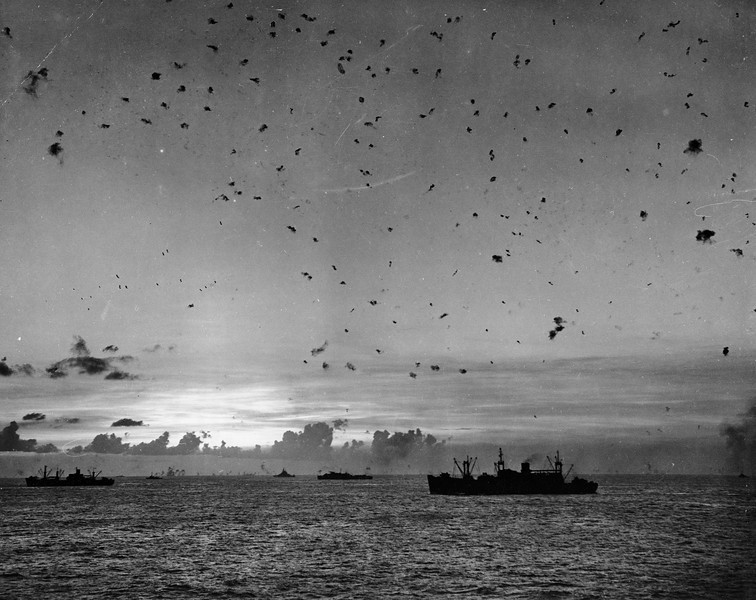 Description of  July 27, 1944: Flak fills the sky as U.S. antiaircraft guns fight off a Japanese attack during the invasion of Saipan, Mariana Islands. (AP Photo)