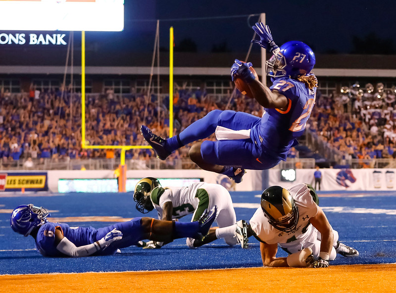 Description of . Boise State running back Jay Ajayi (27) tumbles into the end zone over Colorado State linebacker Max Morgan during the first half of an NCAA college football game in Boise, Idaho, on Saturday, Sept. 6, 2014. (AP Photo/Otto Kitsinger)