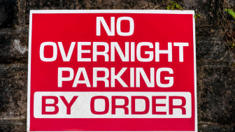 "Red sign reads ""No overnight parking, by order"""