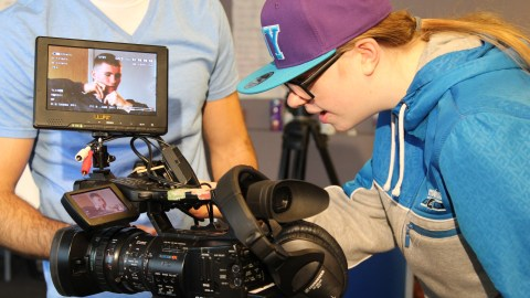 Young woman using the video camera
