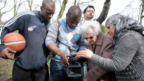 Participants of the film working with the camera