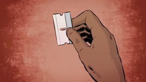 A hand holding a blade