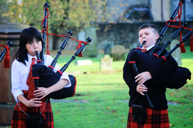 Two Wee Govan Pipers playing the bagpipes