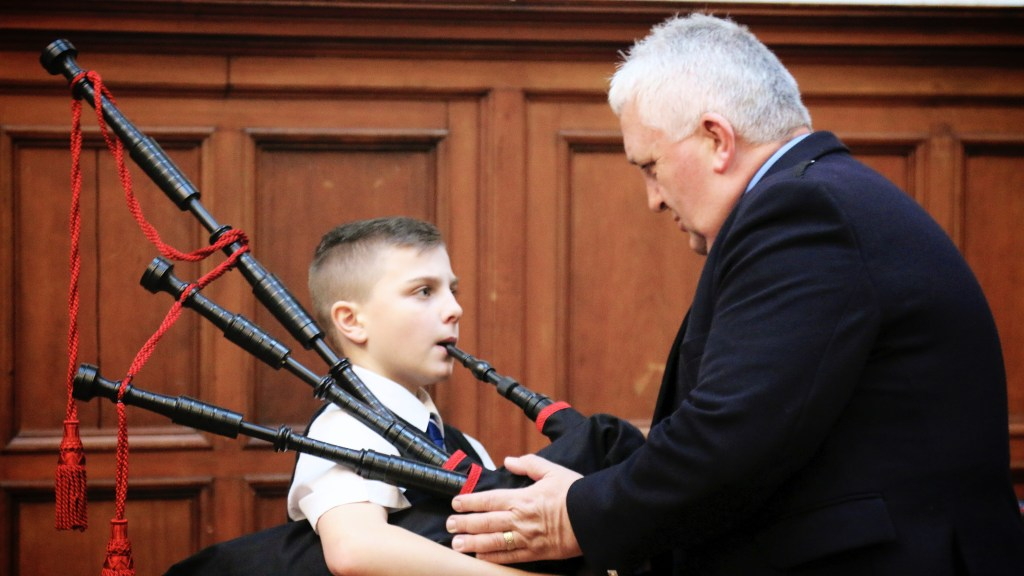 A Wee Govan Piper tuning up