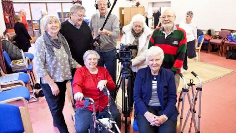 Group of older campaigners with camera equipment
