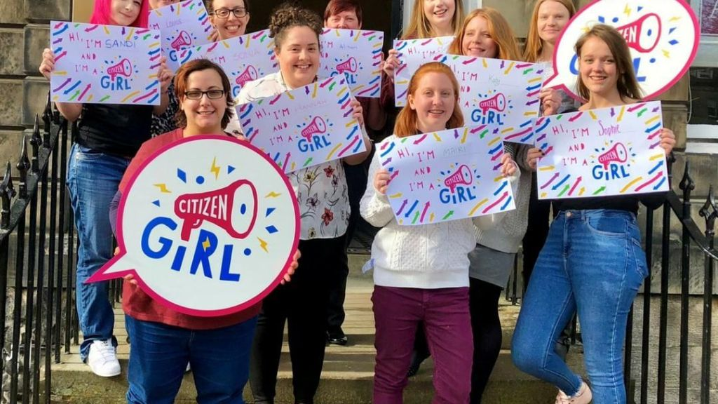 Group of young women with Citizen Girl signs