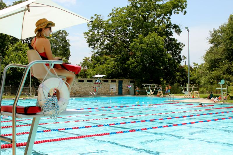 A lifeguard keeps watch at Northwest Park Swimming Pool in Austin
