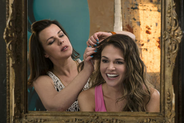 With the help of her friend Maggie (Debi Mazar), single mom Liza (Sutton Foster) recasts herself as a 26-year-old in order to get a coveted publishing job. The new TV Land comedy <em>Younger, </em>made by <em>Sex and the City </em>creator Darren Star, premieres March 31.