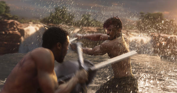 Black Panther (Chadwick Boseman), left, and Erik Killmonger (Michael B. Jordan) battle it out in a fight fueled by dueling visions of resource management.