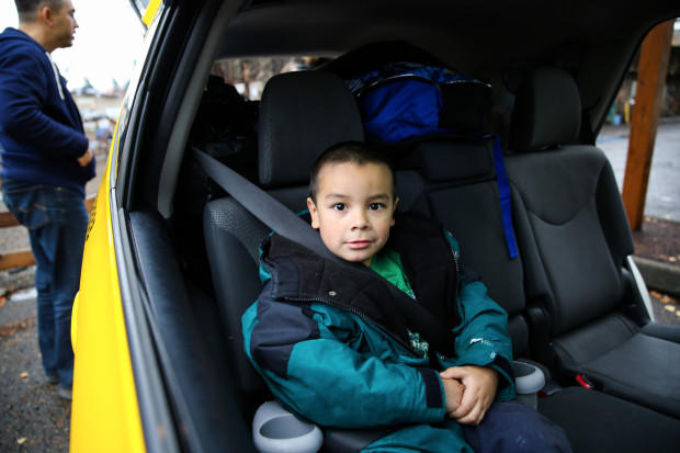 <p>Michael Bunch, 4, sits in a car on what was moving day for his family.&nbsp;Until then, Michael had never had a home of his own.</p>