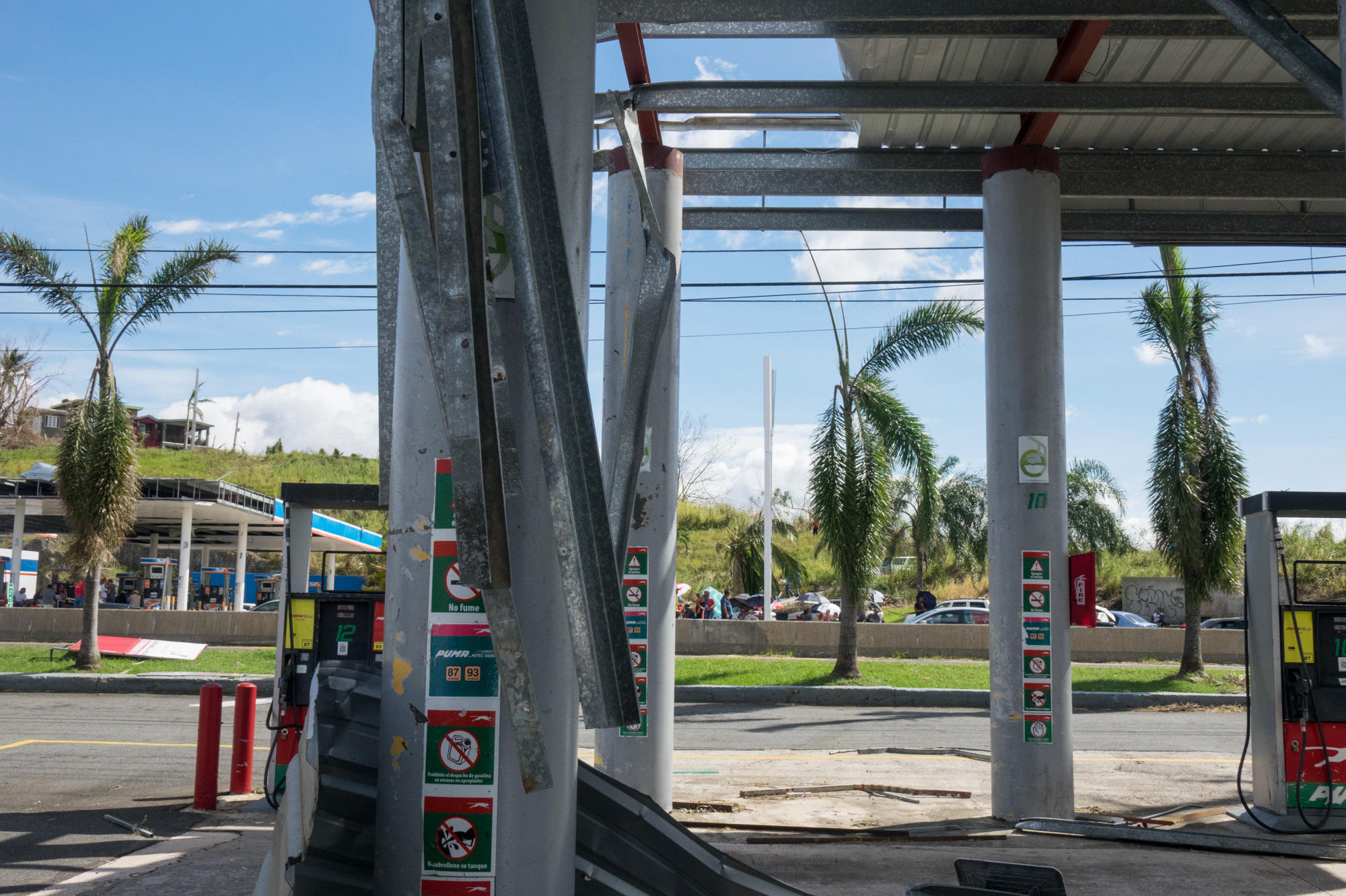At A Gas Station With No Gas Puerto Ricans Settle In For