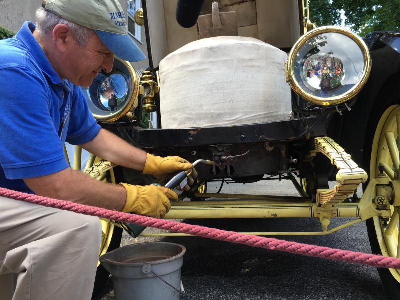 John Hopkins lights ignighter fluid on a Stanley steam car.