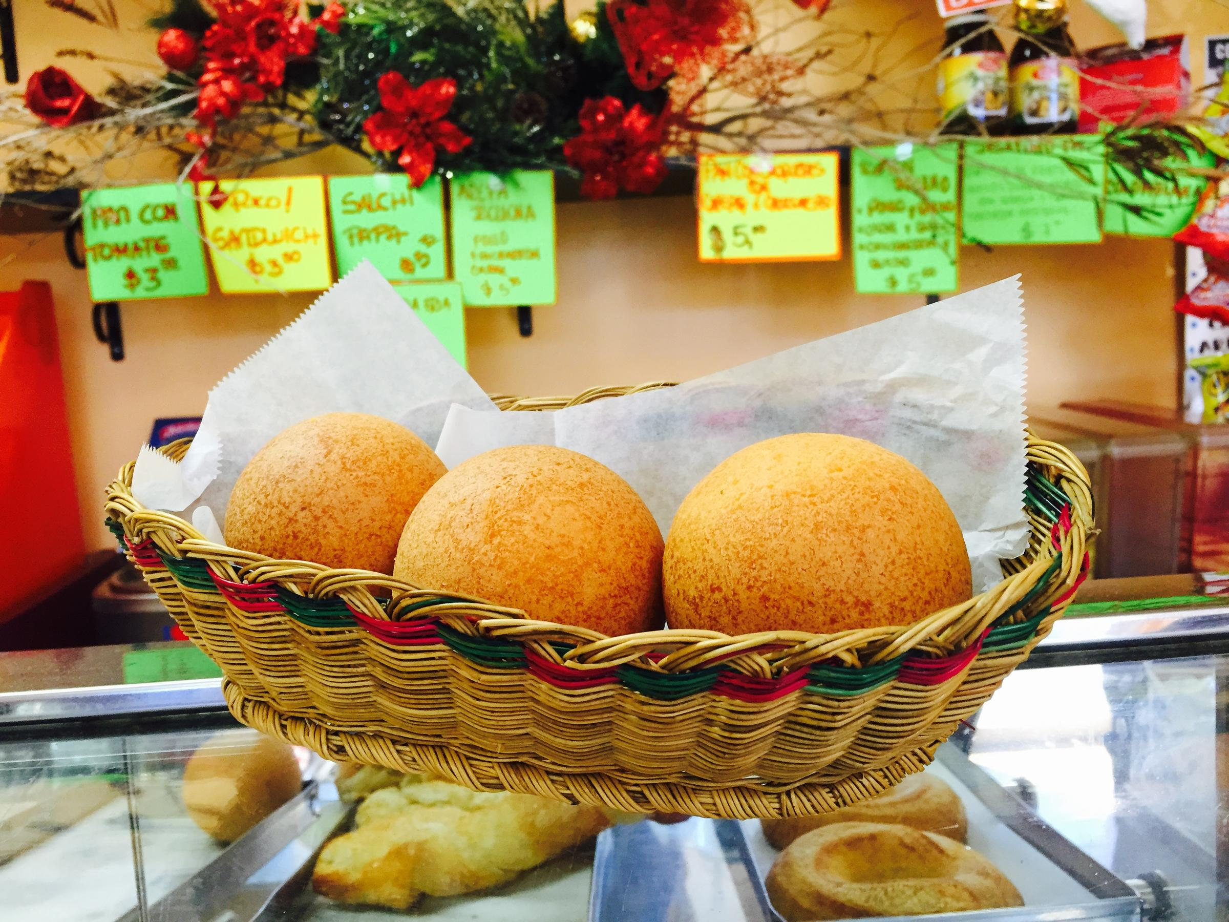 A basket of Christmas bunuelos on the bakery counter at La Candelaria, a Colombian cafe in Kendall.
