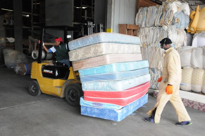 Purpose Recycling Employees Move Discarded Mattresses Delivered From Mecklenberg County