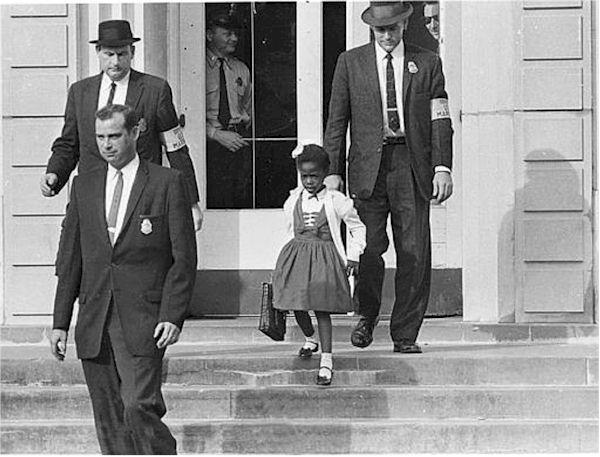 U.S. Marshalls escort Ruby Bridges to integrate William Frantz Elementary School in New Orleans in 1960.