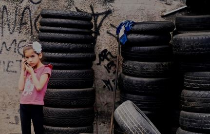 Little girl entertaining herself at her dad's garage in Vidigal -- perhaps Rio's most picturesque favela