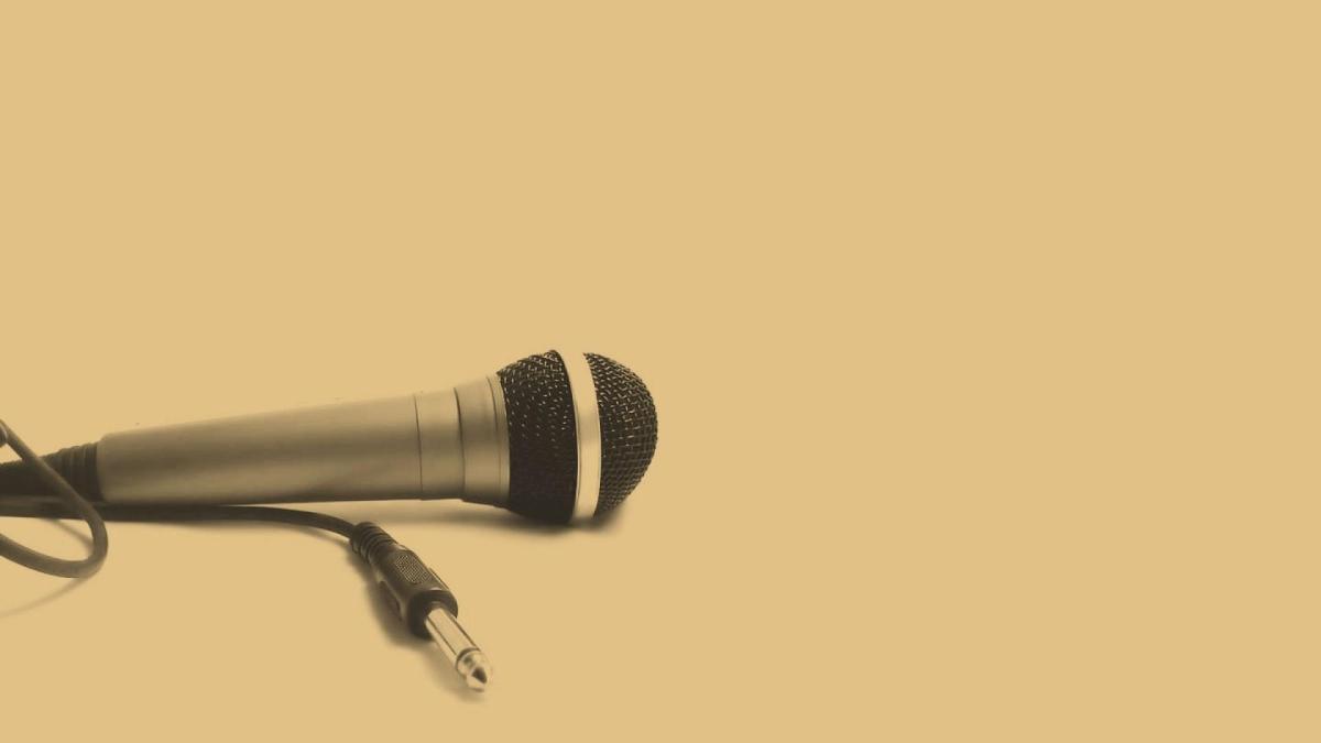 Microphone on khaki background