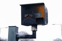 angry populace burning british surveillance cameras