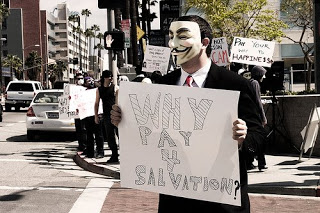 'anonymous' member unmasked, charged w/ hack on scientology