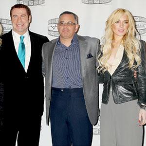 travolta converts troubled actress lindsay lohan to scientology?