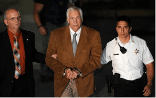 Sandusky Found Guilty, Leaves Court Bound In Handcuffs