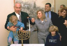 Netanyahu Lighting Hanukah Candles with His Wife and Sons
